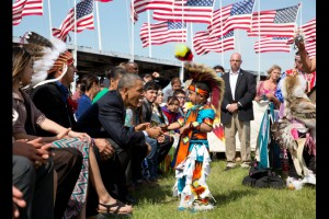 President Obama shaking child's hand at pow-wow